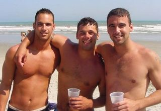 happy-men-drinking-on-beach
